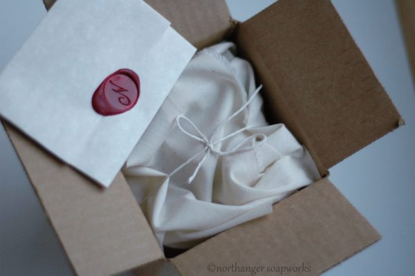 Muslin wrapped soap and wax sealed letter, by Northanger Soapworks