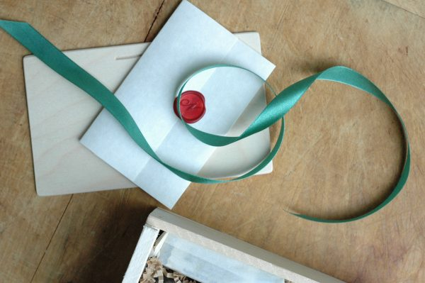 Wax sealed letter from the shop, ribbon, and slide top lid