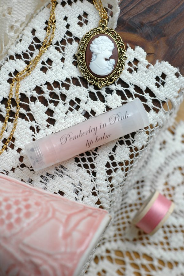 This strawberry lip balm belongs to our Pemberley in Pink collection, a set of pink products inspired by Mr. Darcy's grand estate in Pride and Prejudice. The perfect Jane Austen gift for a lady!
