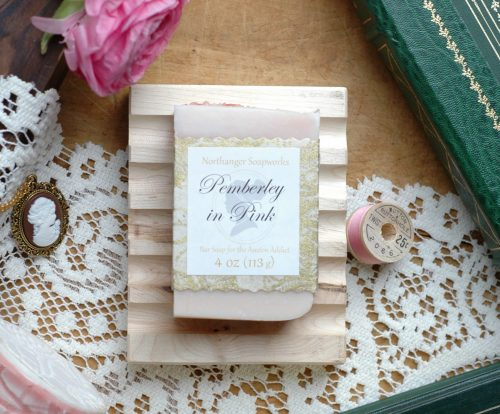 Pemberley in Pink is a bath collection inspired by Mr. Darcy's grand estate in bloom. This Pemberley in Pink bar soap is imbued with the refreshing scent of pink grapefruit, perfect for a warm day. It is the perfect Jane Austen gift for a Lady.