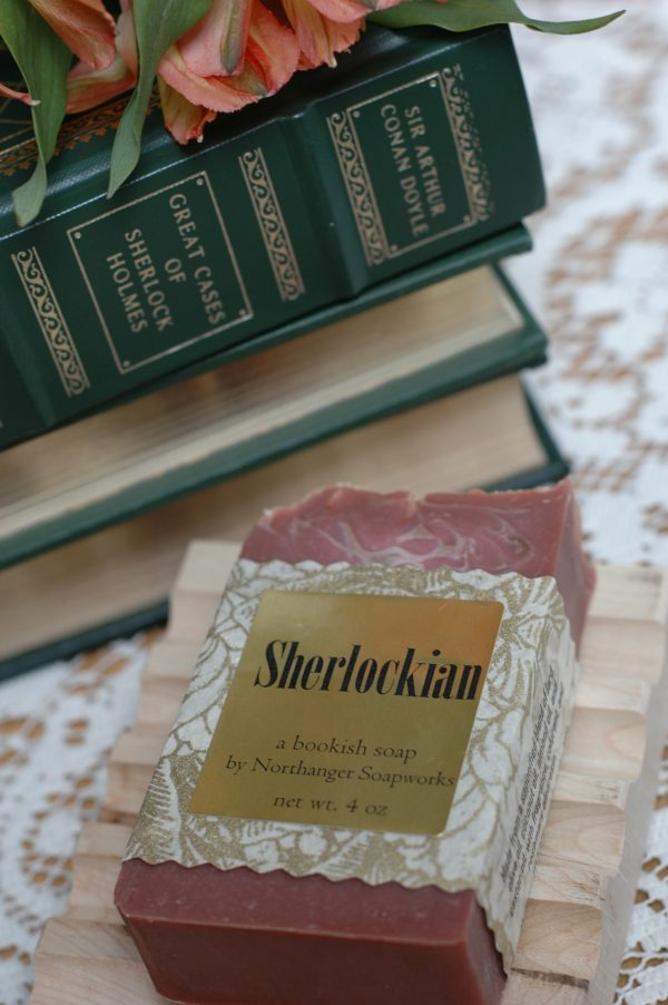 Inspired by Sherlock Holmes, this bookish bar soap is for the ultimate Sherlock fan. It is a muted scarlet color with a wisp of smoke--a nod to one of his most famous works, A Study in Scarlet, as well as his smoking habit. And if you look carefully at the top you will find a series of magnifying glasses! Scented with pipe tobacco, cognac, and cherry vanilla. Available from Northanger Soapworks.